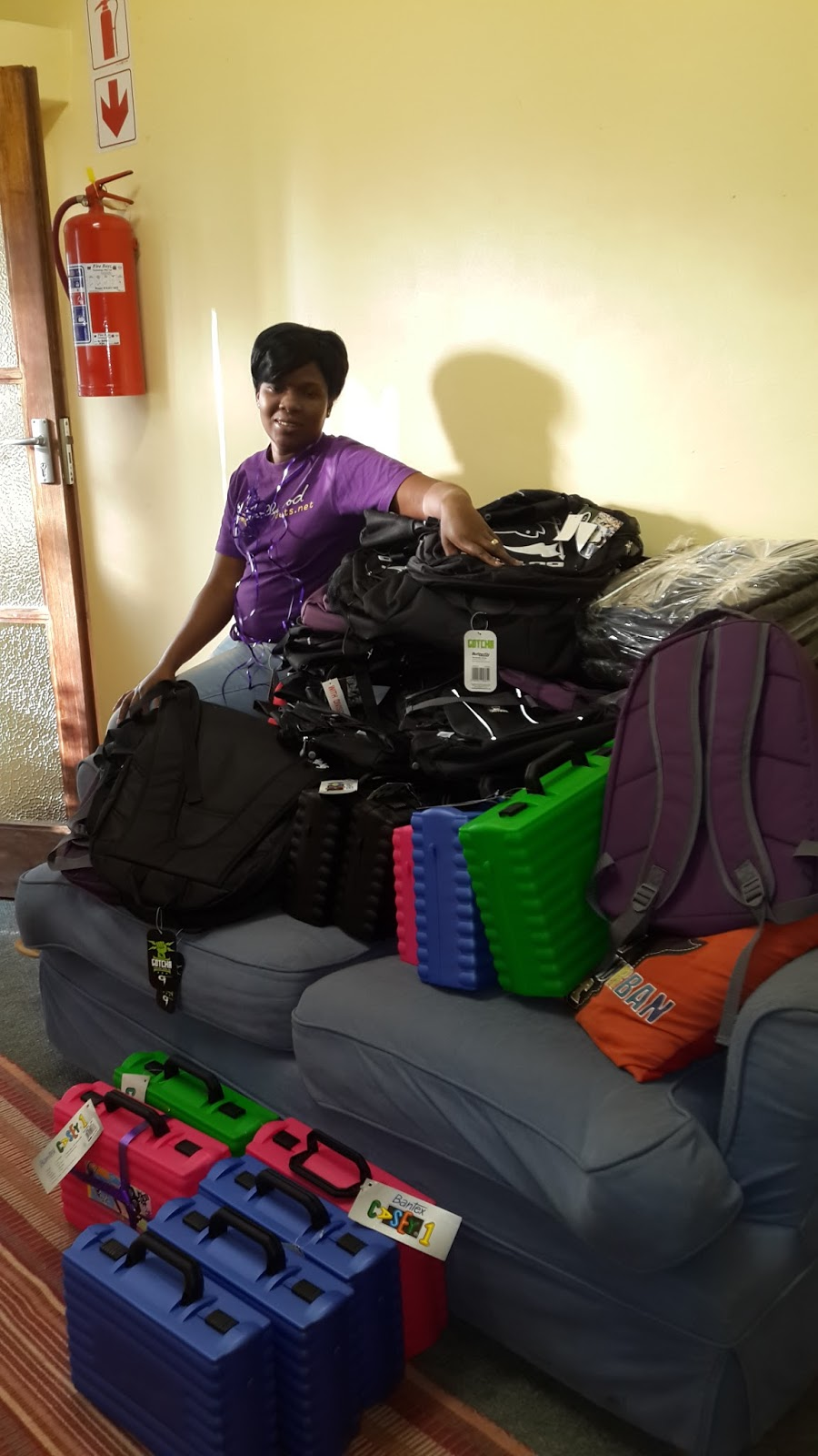 A Hollywoodbets Nelspruit  team member with the new school bags donated to the SAVF Belfast Children's Home - Social Responsibility