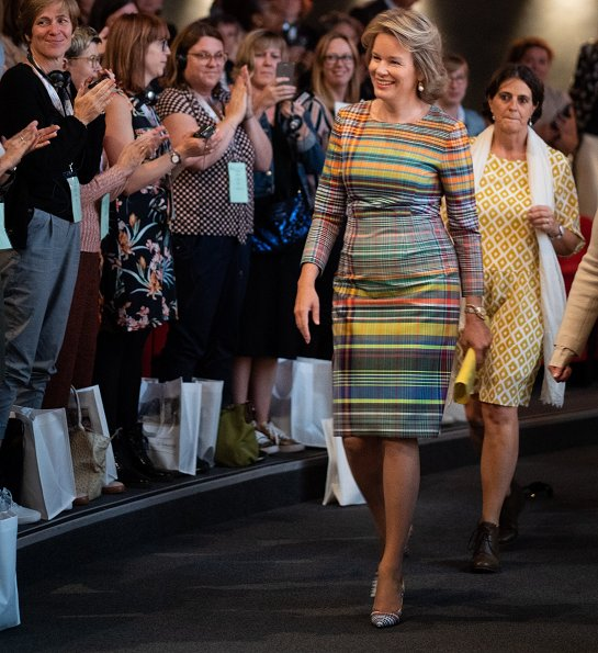 Queen Mathilde wore a plaid madras sheath dress by Dries Van Noten. The National Board of Child Welfare (Oeuvre Nationale de l'Enfance)