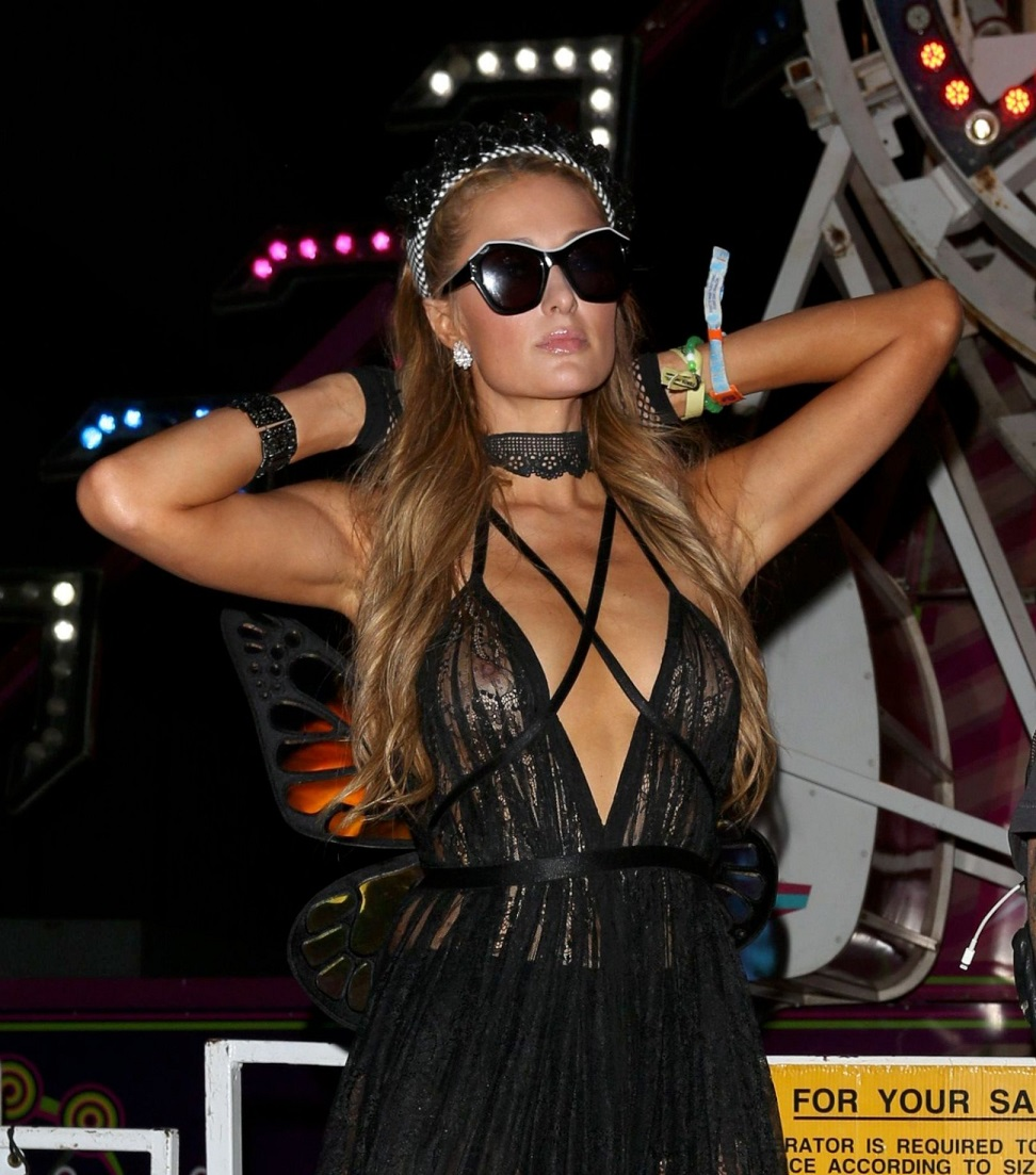 Paris Hilton seemed to be wearing no bra beneath a sheer black dress at Coachella's Neon Carnival on Saturday night, offering onlookers quite the view