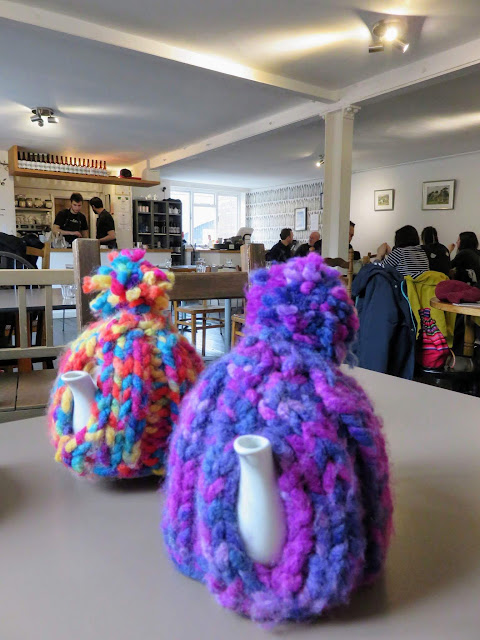Knitted tea cosies at the Warehouse vegetarian cafe in Birmingham, England