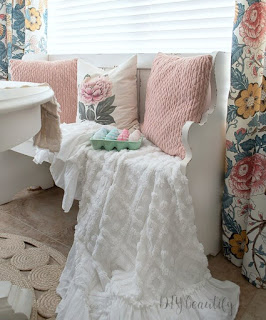 white pew and chenille throw