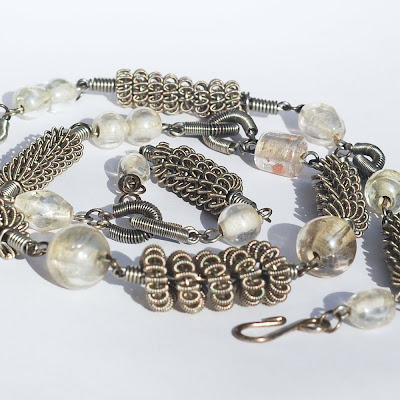 guitar string jewelry by tanith rohe guitar string jewelry upcycled silver and clear bead necklace. Black Bedroom Furniture Sets. Home Design Ideas