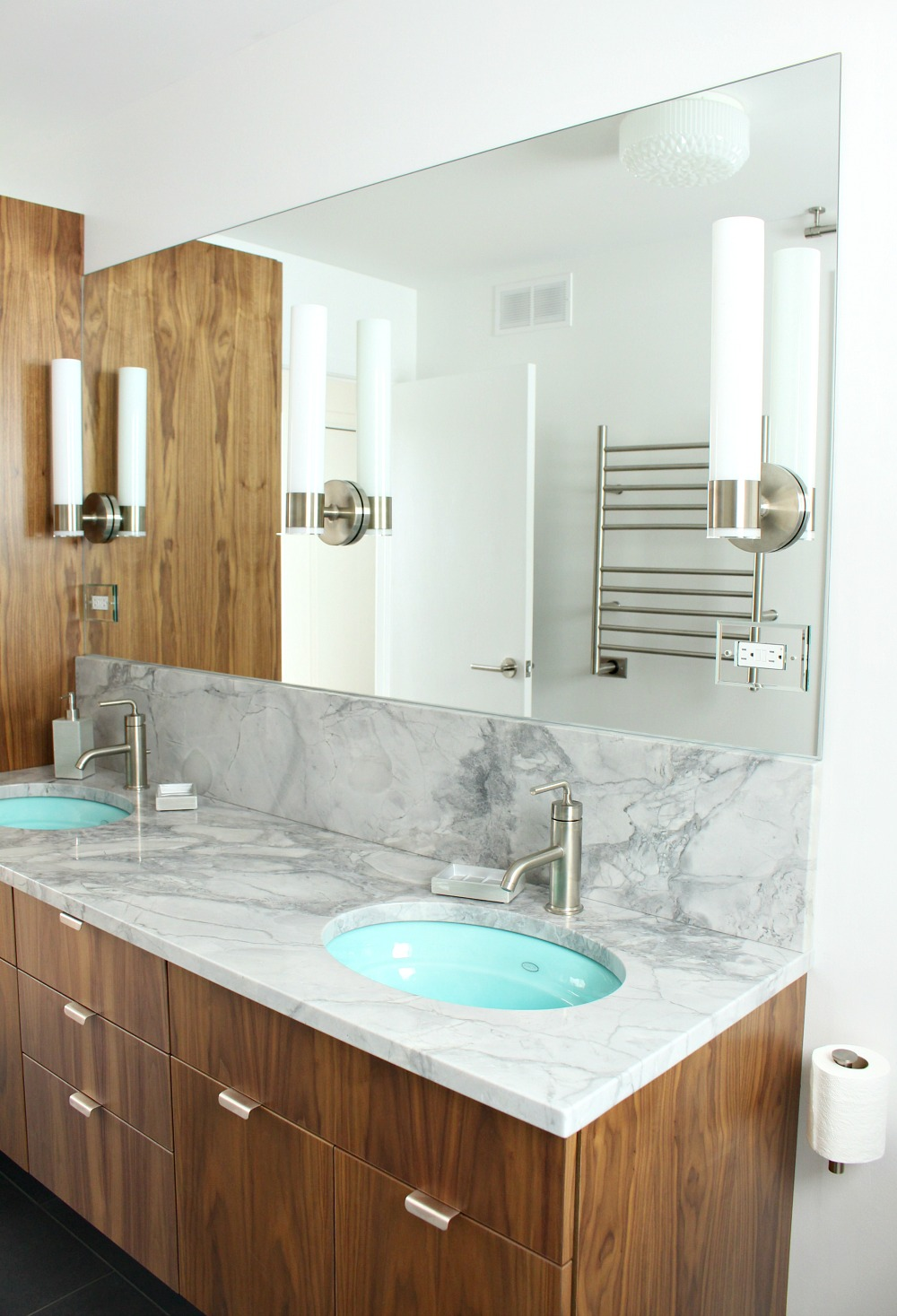 bathroom update kohler purist sconces mounted on a sheet mirror dans le lakehouse