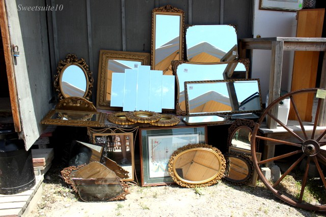 a large collection of antique mirrors