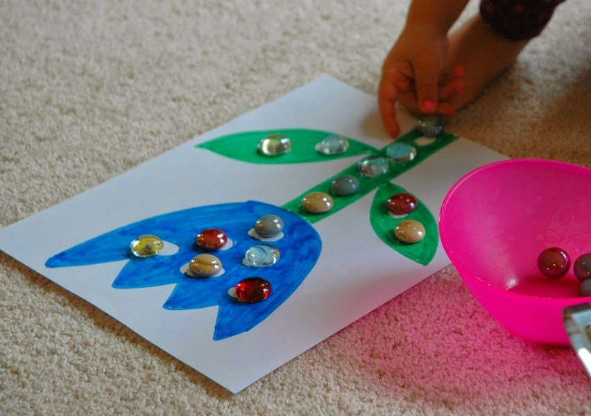 Transferring marbles with tongs for flower theme week