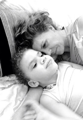black and white picture of Daisy and Steph lying in bed together with Steph gazing lovingly at her daughter