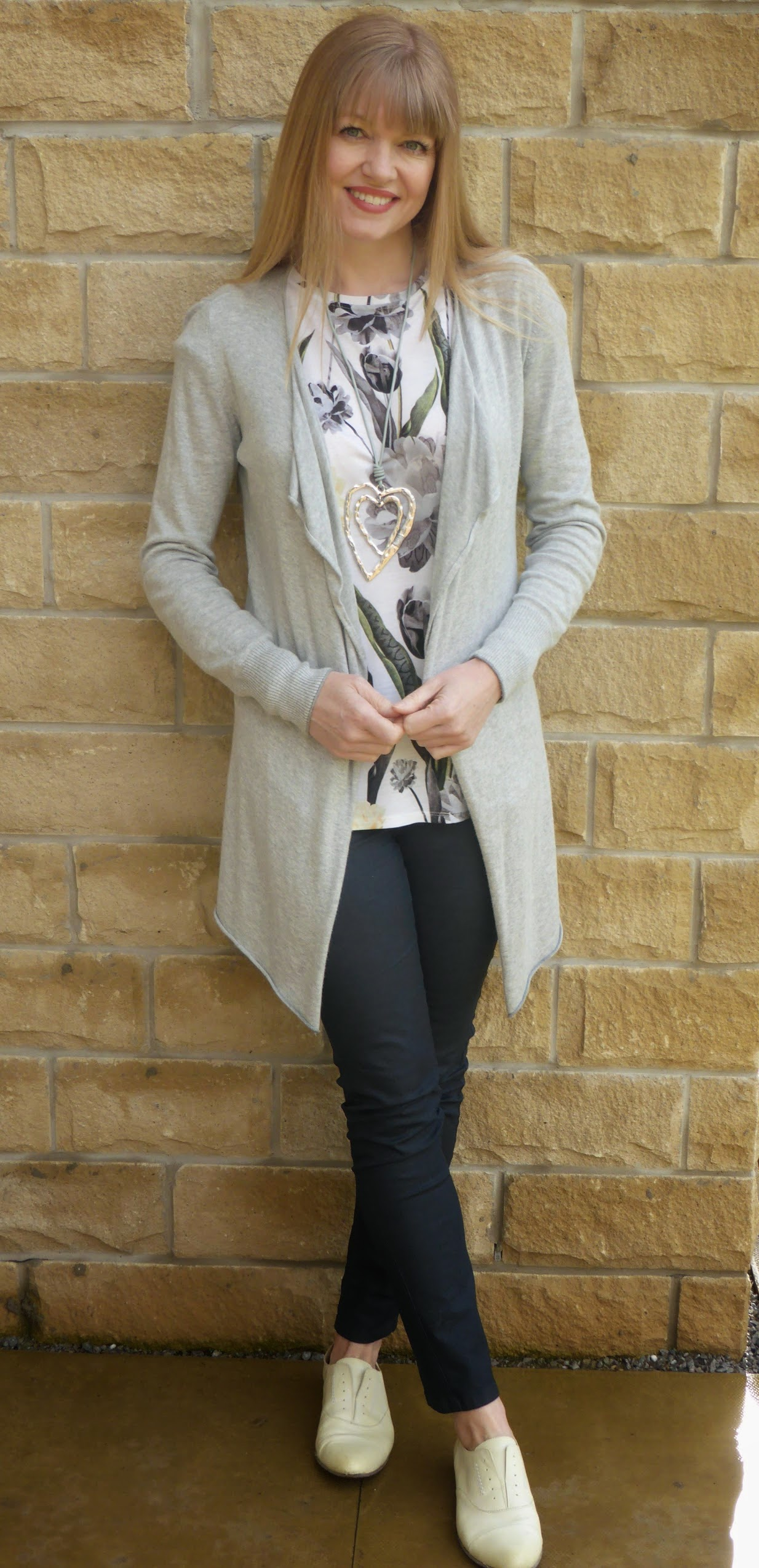 What Lizzy oves, over 40 fashion blogger wears Ted Baker grey and yellow floral tulip top with  long grey waterfall cardigan, grey coated skinny jeans and yellow leather brogues