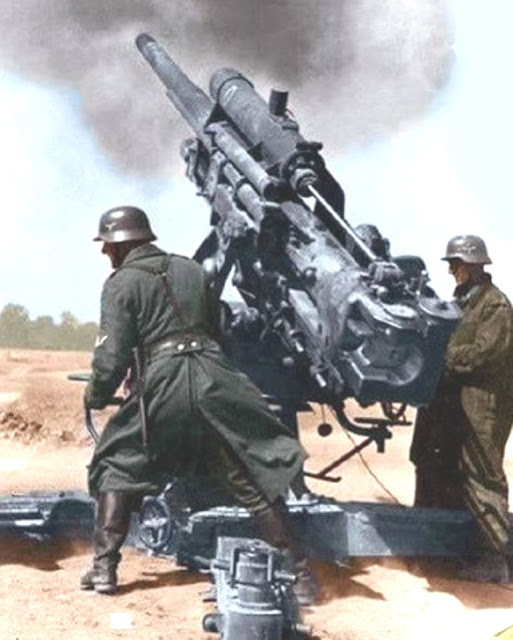 88 mm Flak gun firing Color photo World war II worldwartwo.filminspector.com