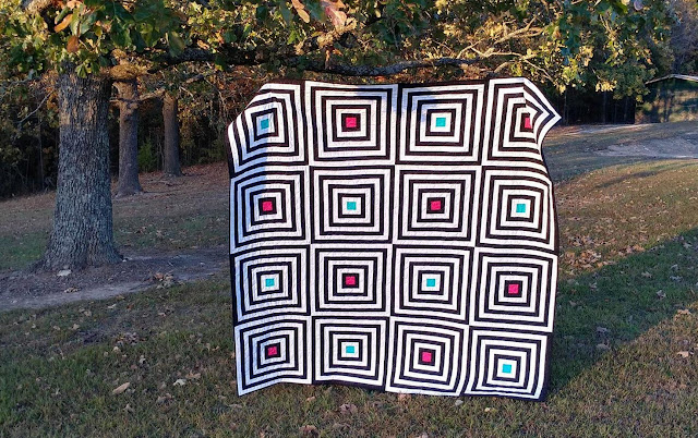 Black and white modern log cabin quilt by Slice of Pi Quilts in Curated Quilts