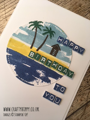 This image shows a hand stamped birthday card with a beach scene and was made using the Waterfront stamp set by Stampin' Up!