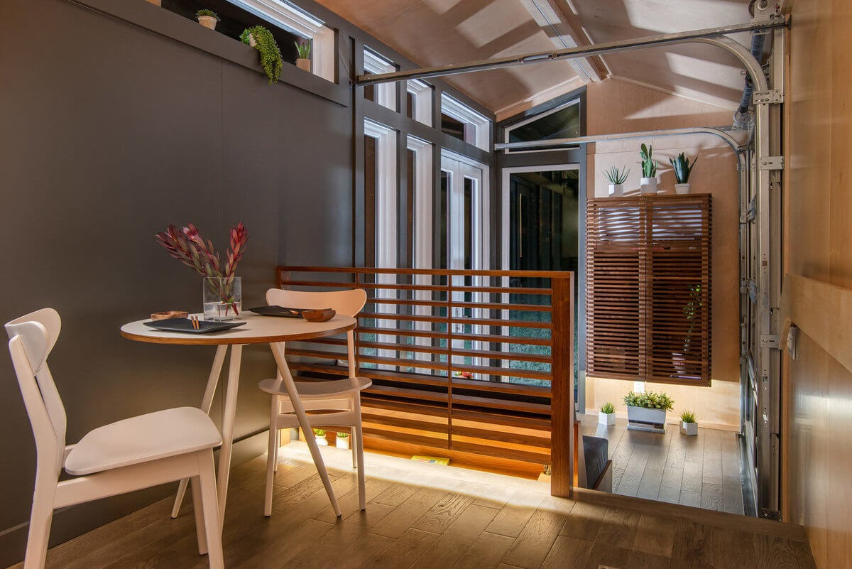 02-Dining-Room-and-Living-Room-New-Frontier-TH-Architecture-The-Orchid-Tiny-House-www-designstack-co