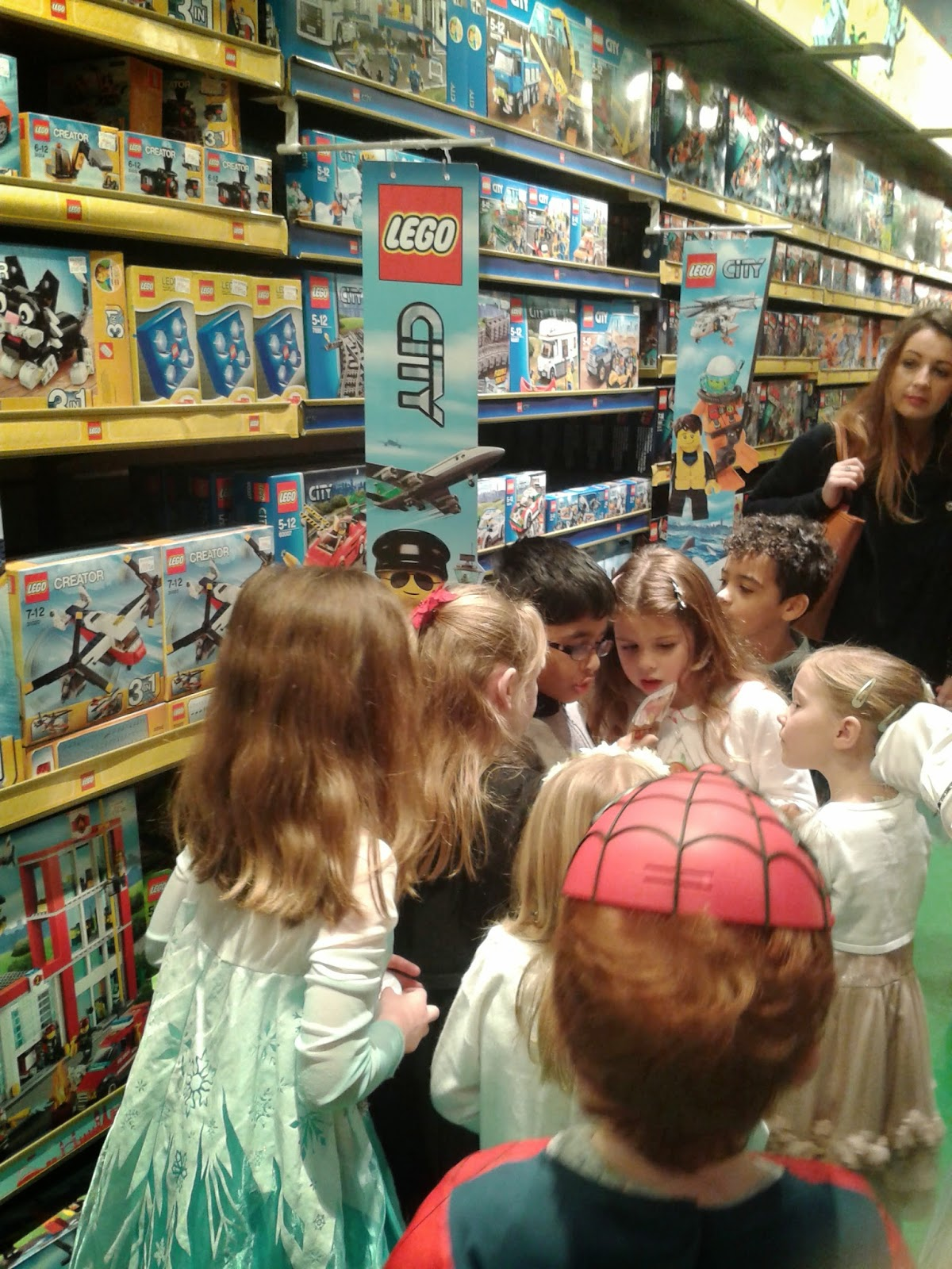 The kids enjoying a treasure hunt at the Pirates & Princesses Party at Hamleys Toystore Cardiff