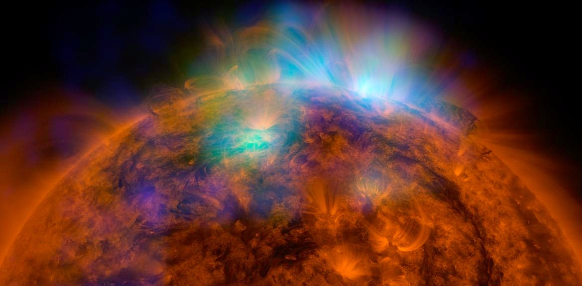 X-rays stream off the sun in this image showing observations from by NASA's Nuclear Spectroscopic Telescope Array, or NuSTAR, overlaid on a picture taken by NASA's Solar Dynamics Observatory (SDO). Image Credit: NASA/JPL-Caltech/GSFC
