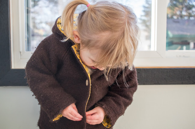 Montessori practical life - buttoning at 3-years-old