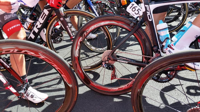 Close up of racing bike wheels intermingled at the starting line of the 2018 Tour Down Under in McLaren Vale. The tag 165 belongs to Ouwain Doull of Team Sky