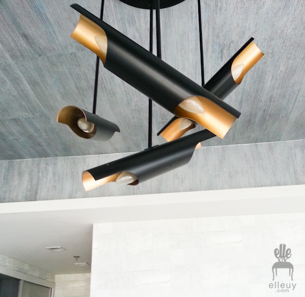 modern black and gold tube light fixture