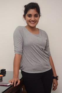 Nivetha Thomas in a beautiful T Shirt and Black Leggings Spicy Pics