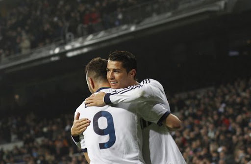 Cristiano Ronaldo celebrates his goal against Celta with Real Madrid teammate Karim Benzema