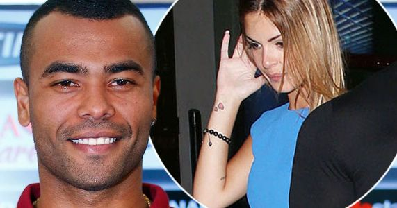Photo: Former ChelseaFC star Ashley Cole cuddles his new born son Sharon Canu