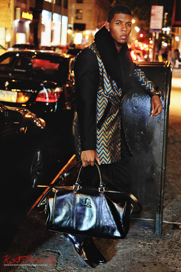 Mens fashion night photoshoot, man's chevron coat with contrasting NY streetscape. Photography by Kent Johnson.