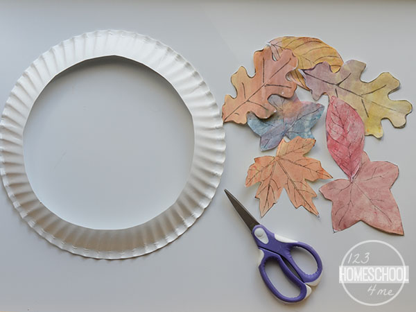 cut out leaves and cut out center of plate for fall craft for kids