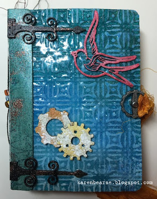 My finished book blues for the cover and chipboard bird, gear, black & copper hinges with the look of a vintage book.