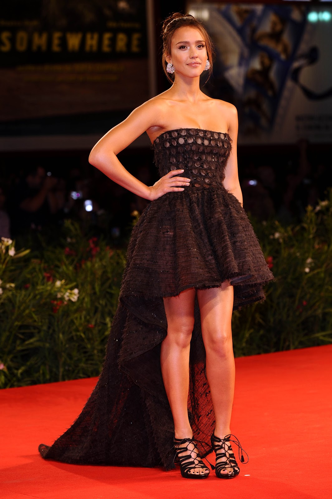 89ef261a3ba Jessica Alba rocked a black strapless Valentino dress with a hi-low hemline  that extended at the back for the Machete premiere in Venice -2010.