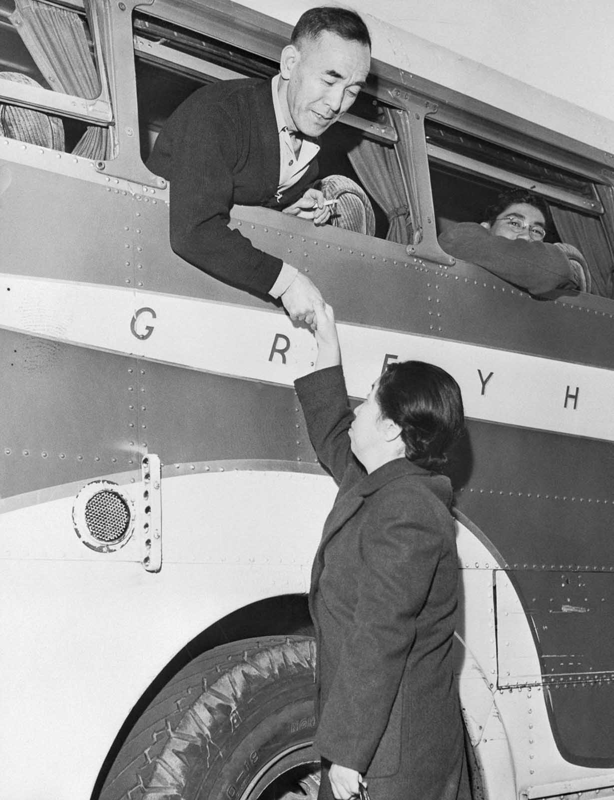 A technician bids farewell to his wife as he departs for Manzanar.