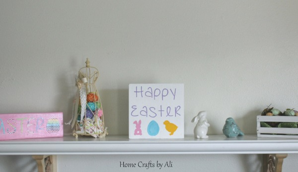 Spring decor display with homemade sign
