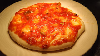 Pizza Sauce spread on pizza base for Margherita pizza Recipe