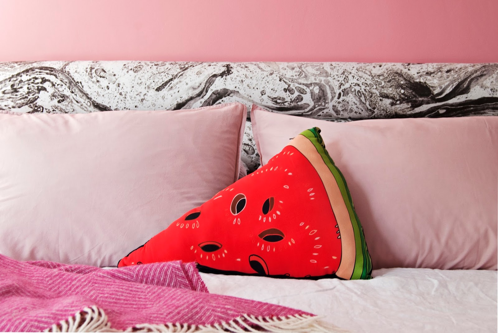 Amara Shoppable Home Inspiration Pages - French For Pineapple Blog - Bedroom with pink walls, marbled headboard and watermelon cushion