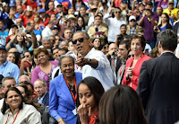 Cuban people trust and like President Obama. He opened diplomatic relations between the US and Cuba and implemented a policy of reaching out to the Cuban people. He is shown here at a baseball game with the wife of Jackie Robinson.
