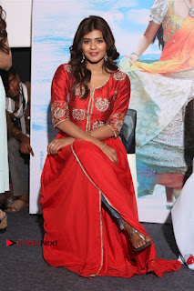 Actress Heba Patel Latest Stills in Red Dress at Mister Movie Trailer Launch Event  0032.jpg
