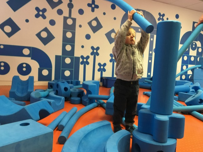 Imagination-playground-at-techniquest-a-toddler-playing-with-blue-blocks