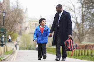 FATHER TALKING SON TO SCHOOL