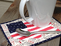 http://trilliumdesign.blogspot.com/2012/06/4th-july-flag-map-mug-rug-pattern.html