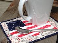 http://trilliumdesign.blogspot.com/2012/06/4th-july-flag-map-mug-rug-pattern.html