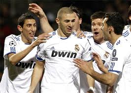 Madrid celebrates Benzema's goal against Lyon