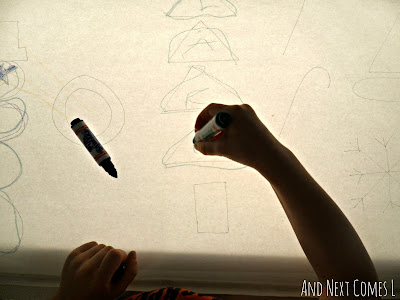 Tracing Christmas shapes and writing letters on the light table from And Next Comes L