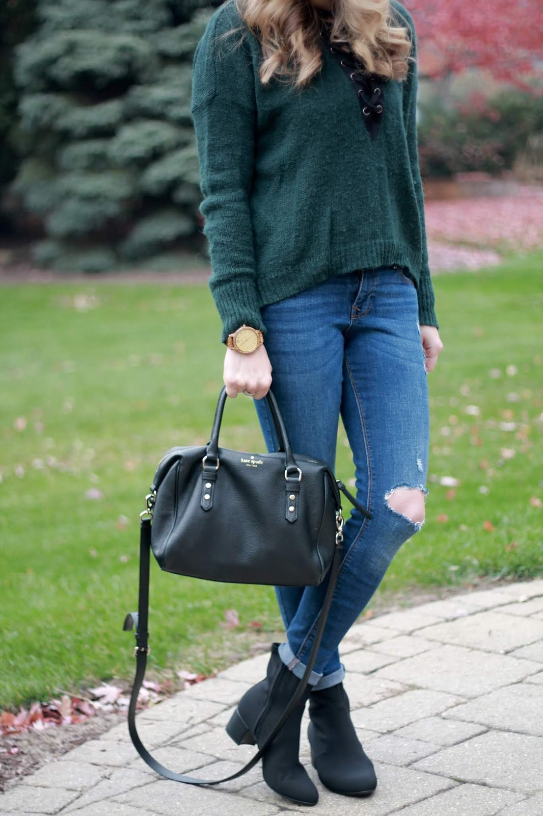 Eva trends grey polka dot dress, ABEO sock booties, black quilted tote, green lace up sweater, distressed jeans, black Kate Spade crossbody, black wide brim hat