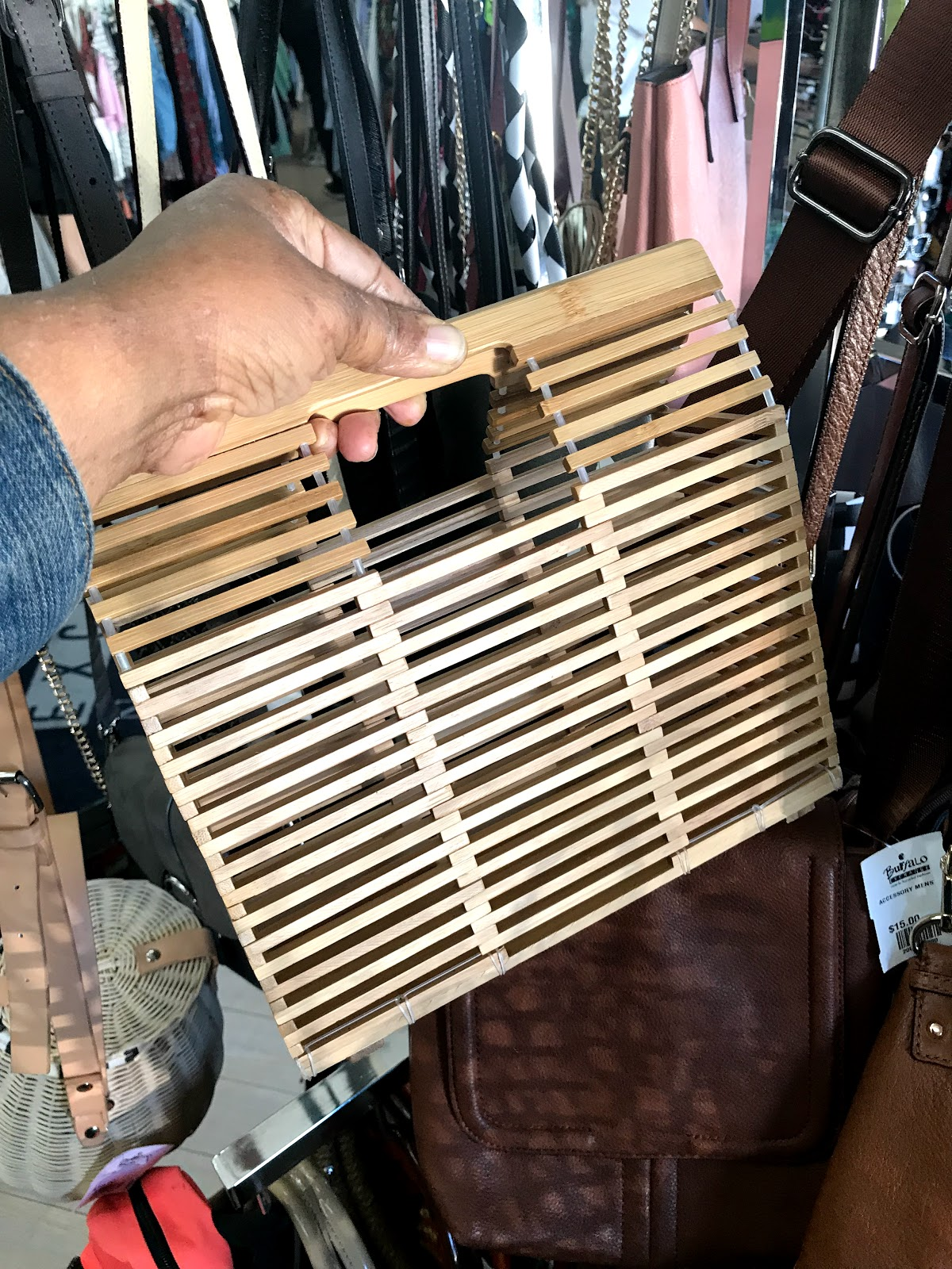 Image: Woman shopping for wooden handbag