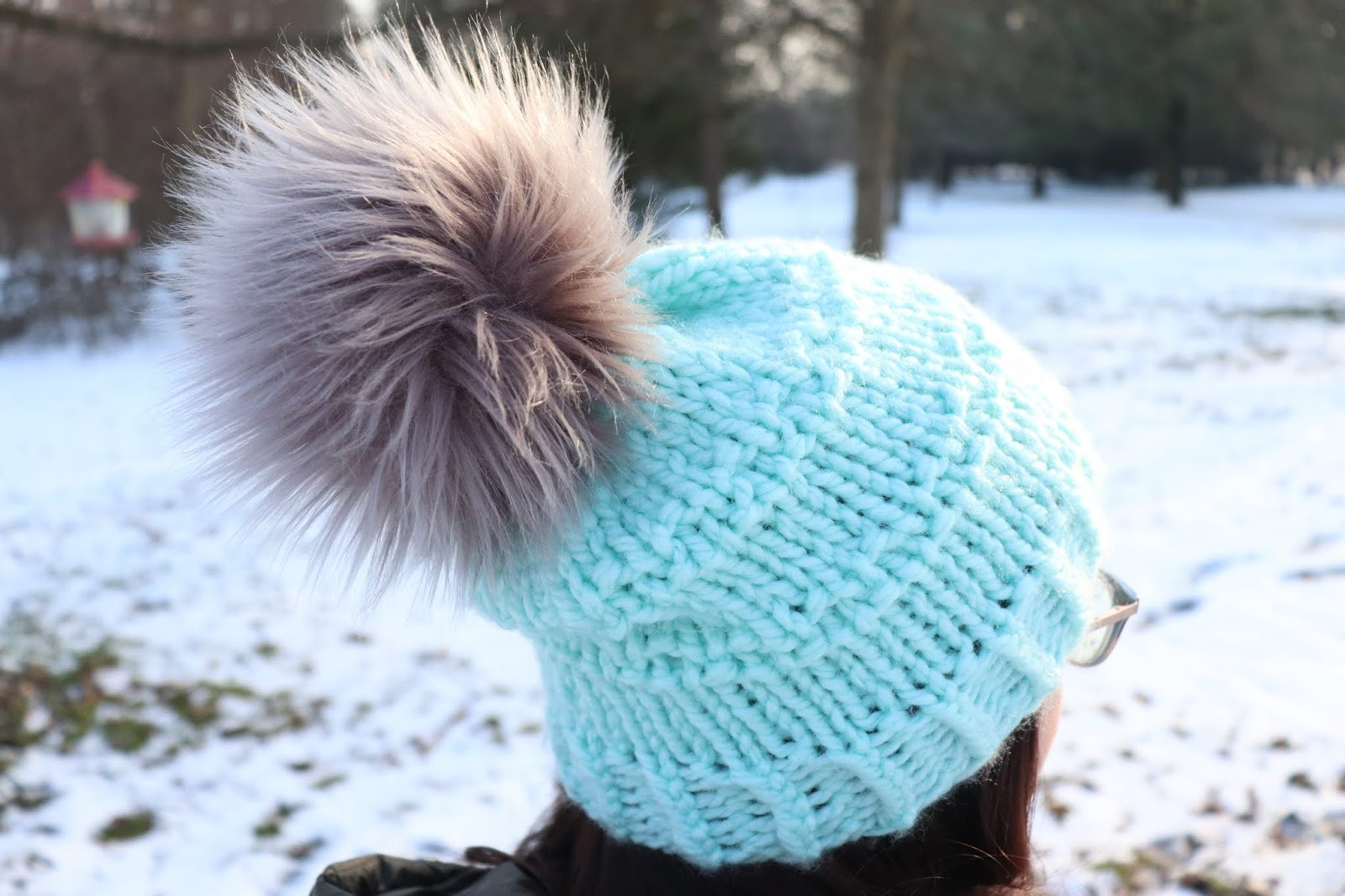 Create a wider base for the pom pom to sit on the hat. After the pom pom is  secured (somewhat) onto your hat with the steps I talked about above 4e48a352614