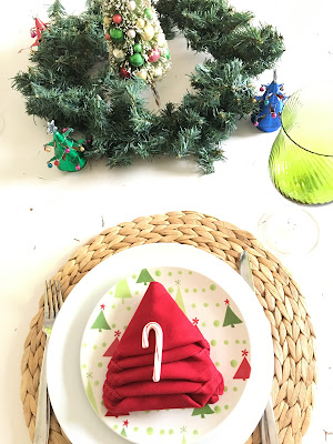 Red Christmas tree napkin fold, Winter wonderland tablescape, bright colors for Christmas, Lime Green and red for Christmas The style sisters tablescape