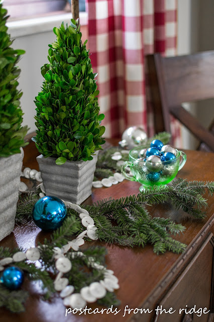 Holiday Tablescape Ideas using mostly vintage items. Love the button garland and the depression glass.