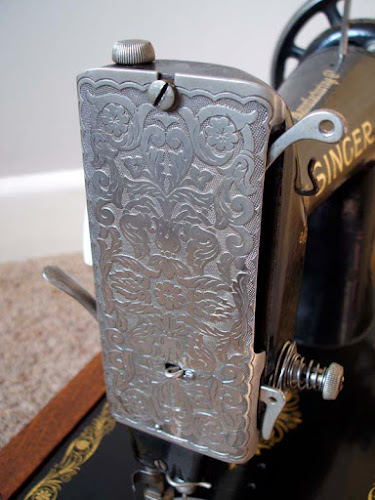Vintage love: early twentieth century cast iron black Singer sewing machine