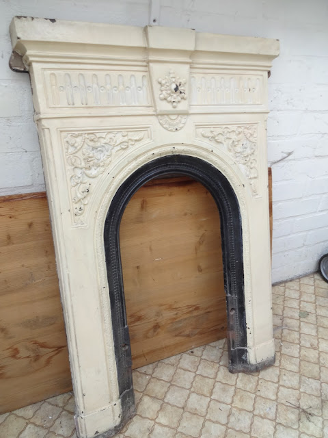 Victorian Fireplace in Layers of Paint
