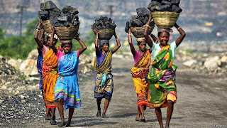 Women carrying coal, they sell these coals to earn their livelihood
