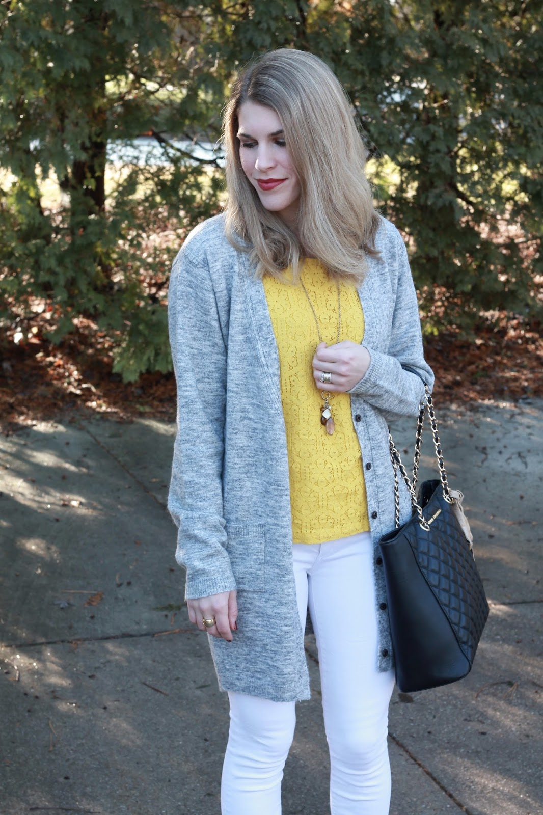 mustard yellow lace top, white jeans, grey boyfriend cardigan, black booties, Greg Michaels black quilted tote