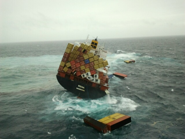 The container ship Rena leans precariously to one side after hitting a reef and stranding itself, 2011  Bay of Plenty, New Zealand
