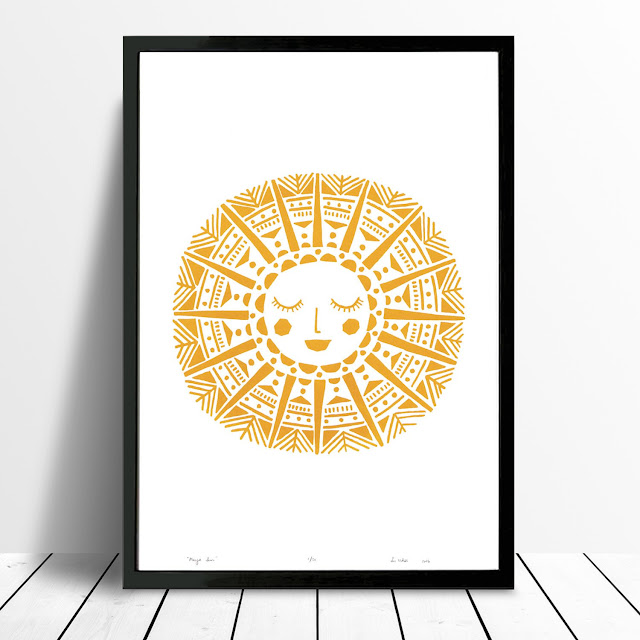 a mustard coloured geometric design of a sun with a smiling face